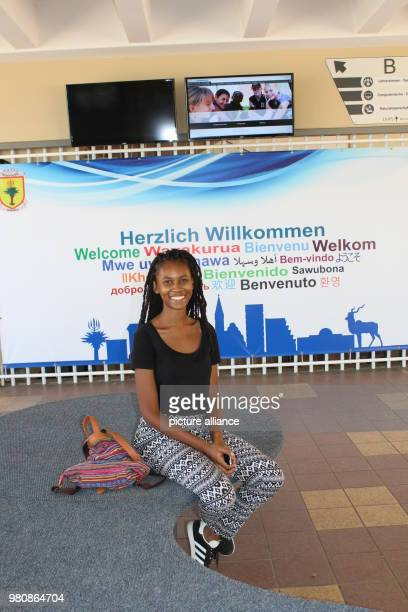 Ngambui Riruako sits in the foyer of the 'Deutsche Hoehere Privatschule Windhoek' The young woman with German and Herero greatgrandparents plans on...