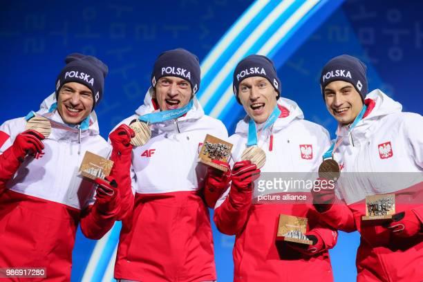 20 February 2018 Pyeongchang South Korea Olympics Nordic Skiing ski jumping team men's award ceremony Medal Plaza The ski jumpers Kamil Stoch Dawid...