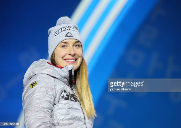 18 February 2018 Pyeongchang South Korea Olympics womens Skeleton award ceremony Medal Plaza Jacqueline Loelling of Germany walks to the podium for...