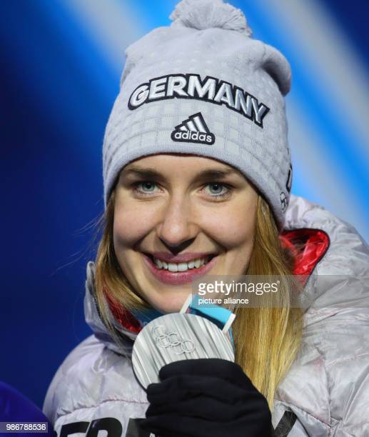 February 2018, Pyeongchang, South Korea, Olympics, womens, Skeleton, award ceremony Medal Plaza: Jacqueline Loelling of Germany holds up her silver...