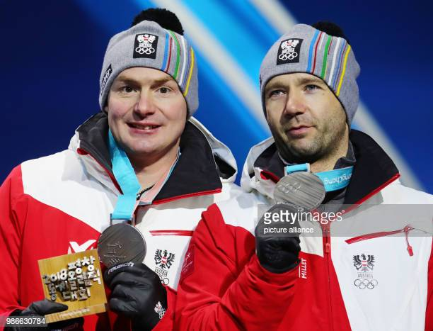 14 February 2018 Sout Korea Pyeongchang Olympic Doubles Luge Men Medal Ceremony Medal Plaza Peter Penz and Georg Fischler of Austria present their...