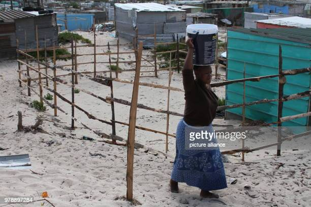 09 February 2018 South Africa Cape Town Khayelitsha Mandla Qosholo who lives in the Khayelitsha slum area outside Cape Town has to carry 25litre...