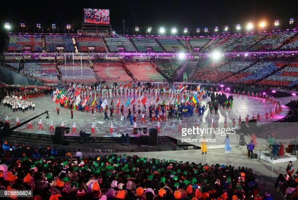 February 2018, South Korea, Pyeongchang: Olympics, Closing Ceremony, Olympic Stadium: Athletes enter the stadium during the final celebrations....