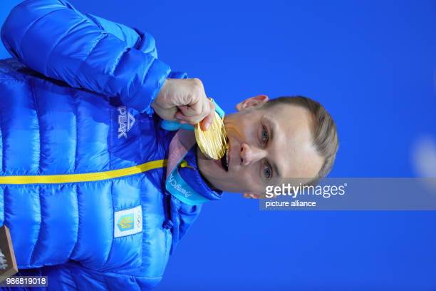 19 February 2018 South Korea Pyeongchang Olympics Freestyle Skiing Men's Aerials award ceremony Medal Plaza Alexander Abramenko from Ukraine poses...