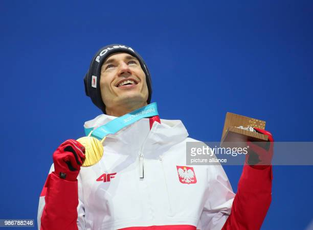 18 February 2018 South Korea Pyeongchang Olympics Nordic Skiing Ski Jumping big hill award ceremony medal plaza Kamil Stoch from Poland cheers over...