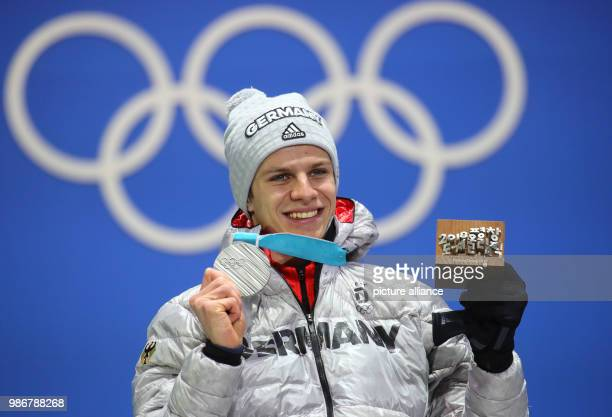 18 February 2018 South Korea Pyeongchang Olympics Nordic Skiing Ski Jumping big hill award ceremony medal plaza Andreas Wellinger from Germany cheers...