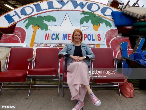 February 2018, USA, Los Angeles: The German actress Nina Rausch sits on old movie theatre chairs in a shop with film memorabilia. Photo: Barbara...