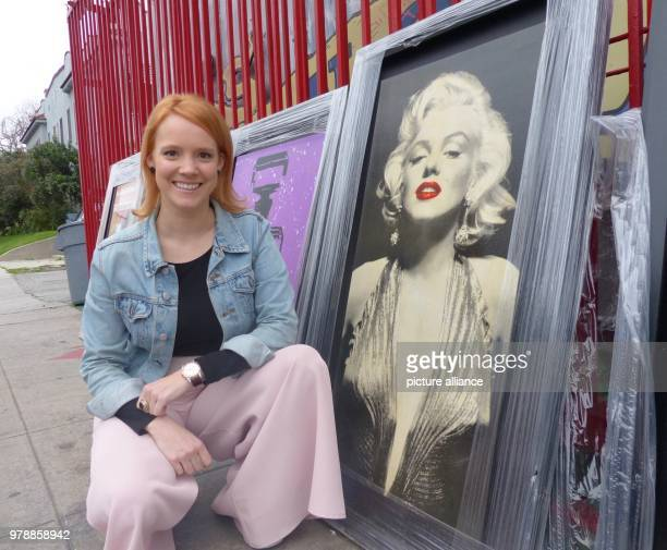 February 2018, USA, Los Angeles: The German actress Nina Rausch stands next to an image of Marilyn Monroe in a shop with film memorabilia. Photo:...