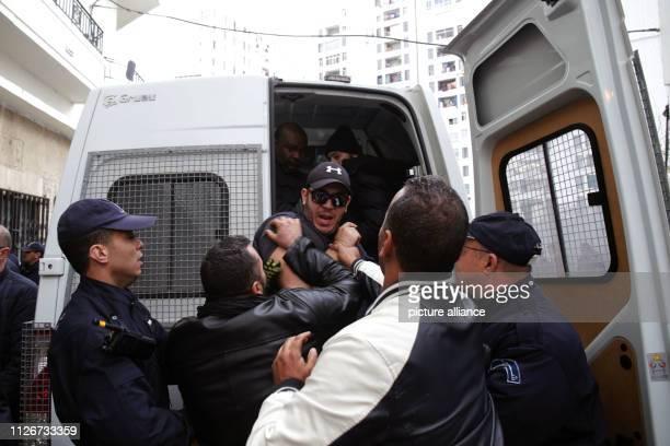 February 2019, Algeria, Algiers: Algerian policemen arrest a protester during a demonstration against the candidacy of Algerian President Abdelaziz...