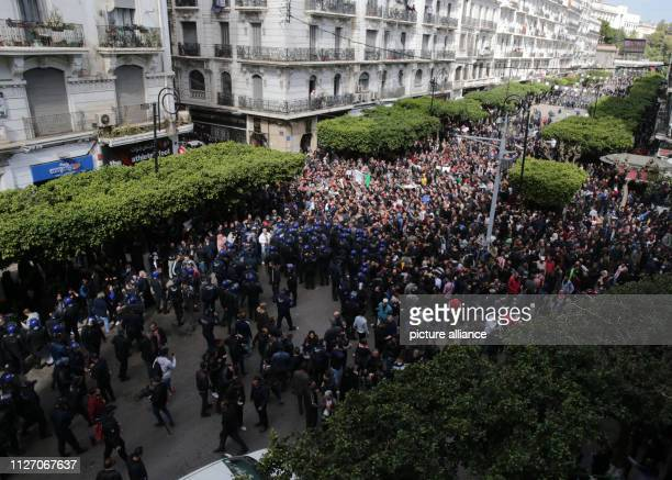 Algerian policemen face protestors during a demonstrtion against the candidacy of Algerian President Abdelaziz Bouteflika for a fifth term in office...