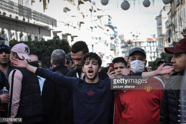 An Algerian protester shouts slogans during a demonstration against the candidacy of Algerian President Abdelaziz Bouteflika for a fifth term in...