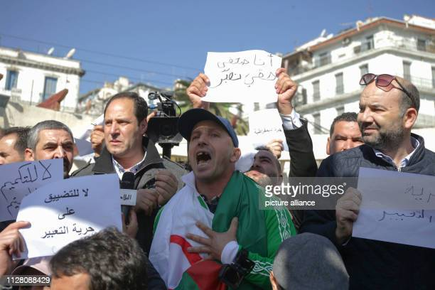 People shout slogans during a protest by journalists against censorship of the press by the authorities as part of the demonstrations against the...