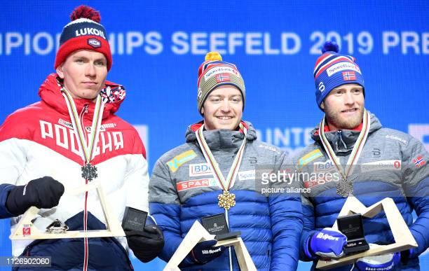 Crosscountry skiing world championship skiathlon 2 x 15 km men Second placed Alexander Bolshunov from Russia winner Sjur Röthe from Norway and third...