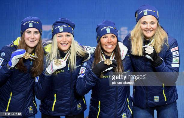 Crosscountry skiing world championship relay 4 x 5 km ladies medal ceremony Ebba Andersson Frida Karlsson Charlotte Kalla and Stina Nilsson from...