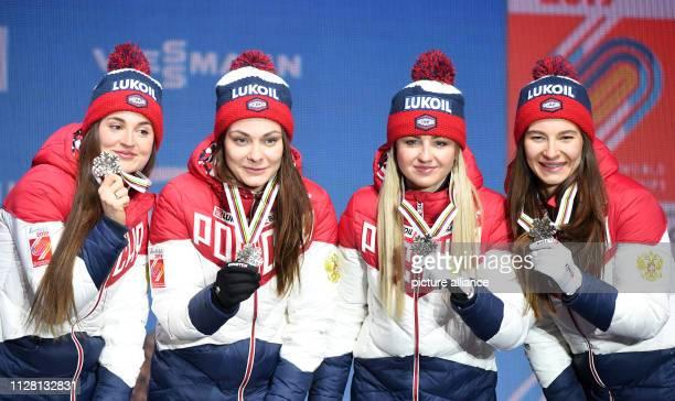Crosscountry skiing world championship relay 4 x 5 km ladies medal ceremony Yulia Belorukova Anastasia Sedova Anna Nechaevskaya and Natalia Nepryaeva...