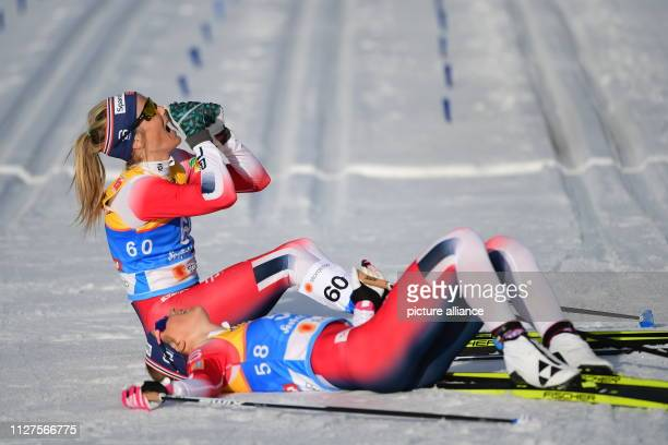Nordic skiing world championship crosscountry skiing 10 km classic ladies Therese Johaug from Norway cheers next to Ingvild Flugstad Oestberg from...