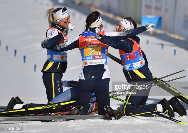 Nordic skiing World championship crosscountry relay 4 x 5 km women Frida Karlsson Stina Nilsson Charlotte Kalla and Ebba Andersson from Sweden cheer...