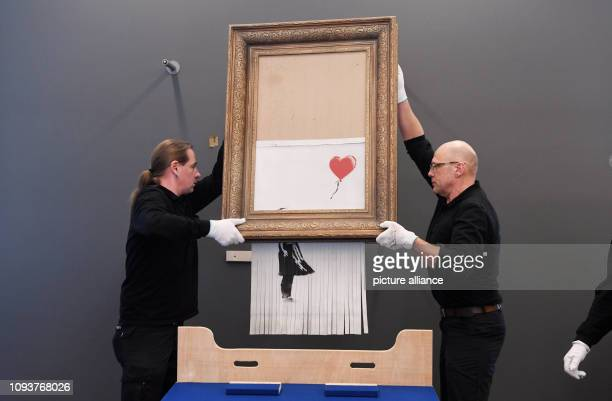04 February 2019 BadenWuerttemberg BadenBaden The shredded Banksy painting 'Love is in the Bin' is hung in the Frieder Burda Museum The work will be...
