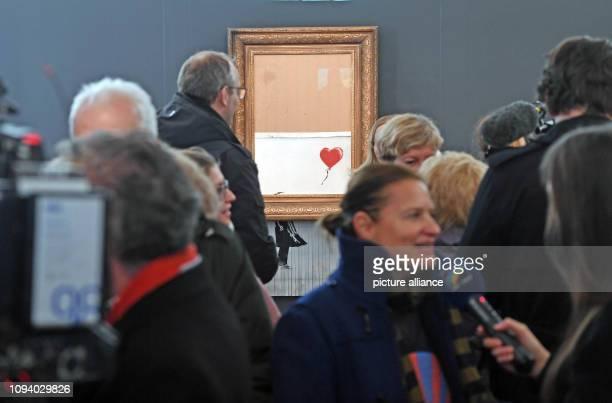 05 February 2019 BadenWuerttemberg BadenBaden Visitors to the Frieder Burda Museum view the shredded Banksy painting 'Love is in the Bin' The work...
