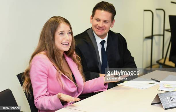 Cathy Hummels and her lawyer Christian Oliver Moser are sitting in the courtroom of the Landgericht München I before the start of the trial The wife...