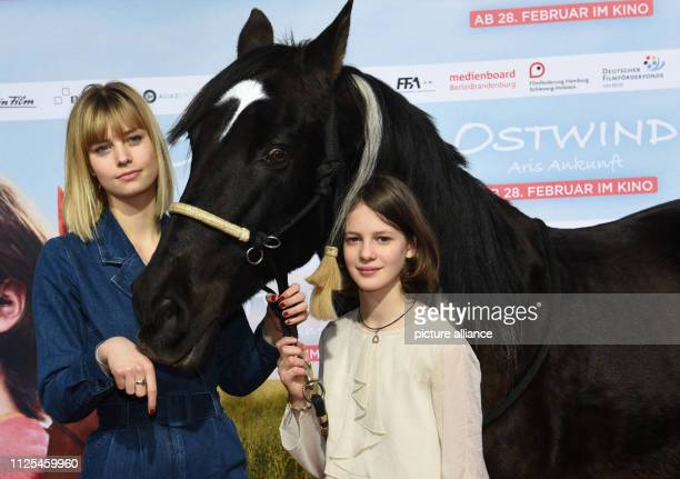 The actresses Hanna Binke and Luna Paiano come with a horse to the premiere of the movie Ostwind Aris Ankunft Photo Angelika Warmuth/dpa