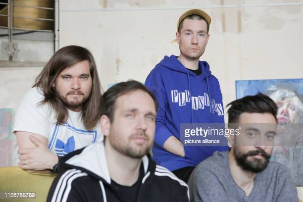 Will Farquarson Kyle J Simmons Chris Wood and Dan Smith from the British band Bastille sit in the hotel nhow after an interview Photo Lisa Ducret/dpa