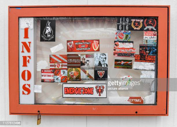 """February 2019, Brandenburg, Cottbus: Stickers can be seen on a glass box at the fan booth at the """"Stadium of Friendship"""" of the 1st FC Energie..."""
