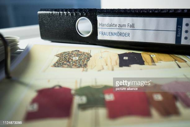 Files and photos of the deeds of the murderer Fritz Honka are lying on a table in the police museum In the police museum of the Hanseatic city some...