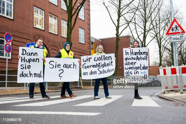 Participants of a warning strike of the wageearners at schools and universities in Hamburg stand in front of the WichernSchule in the district Horn...