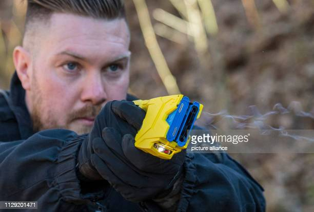Denis Altvater of the Frankfurt police robbery squad fires a taser at his target After a test phase the stun guns will be part of the officers'...