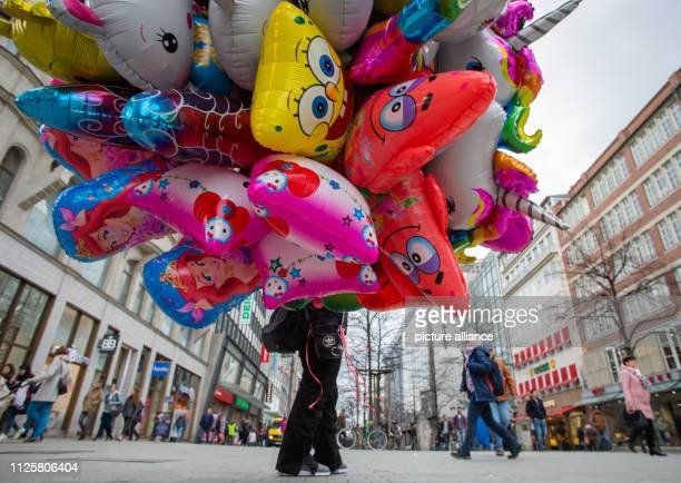 A balloon salesman is standing in the city centre with his colourful goods Photo Raphael Knipping/dpa