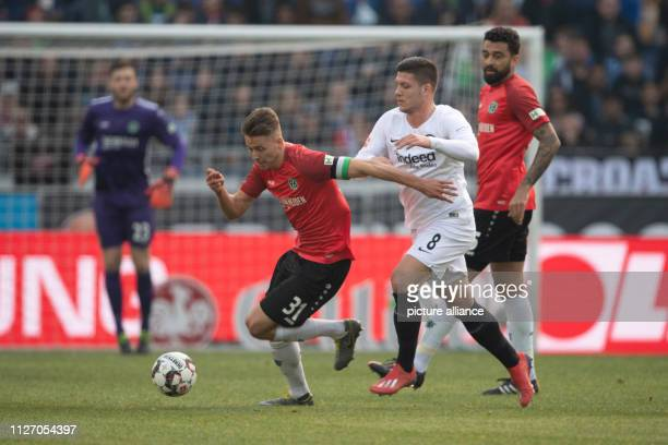 Soccer Bundesliga Hannover 96 Eintracht Frankfurt 23rd matchday in the HDIArena Hanover's Waldemar Anton plays against Frankfurt's Luka Jovic Photo...