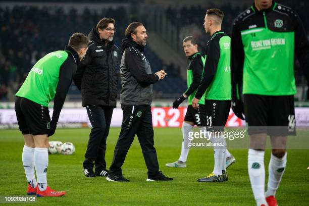 Soccer Bundesliga Hannover 96 RB Leipzig 20th matchday in the HDIArena Hannover's coach Thomas Doll and Hannover's cocoach Ralf Zumdick talk to...