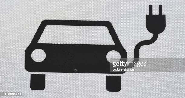 """February 2019, Mecklenburg-Western Pomerania, Jarmen: A symbol of """"electrically powered vehicles"""" can be found on the """"Demminer Land"""" tank and..."""