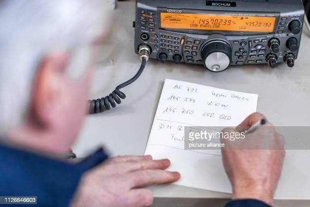 February 2019, North Rhine-Westphalia, Bochum: Guido Elsner, employee at the observatory, notes down radio frequencies and identifiers on a piece of...