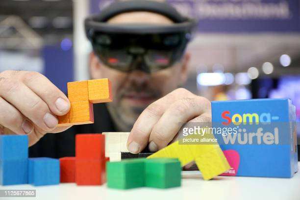18 February 2019 North RhineWestphalia Köln Thorsten Dollmann demonstrates the assembly of a Soma cube with the help of a HoloLens at the special...