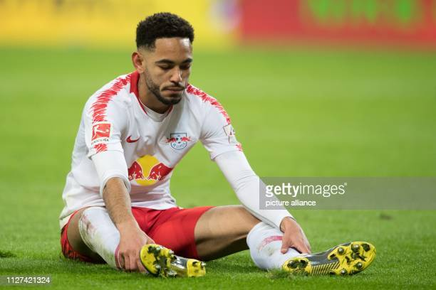 Soccer Bundesliga 23rd matchday RB Leipzig 1899 Hoffenheim in the Red Bull Arena Leipzig Leipzig's Matheus Cunha sits on the grass during the game...