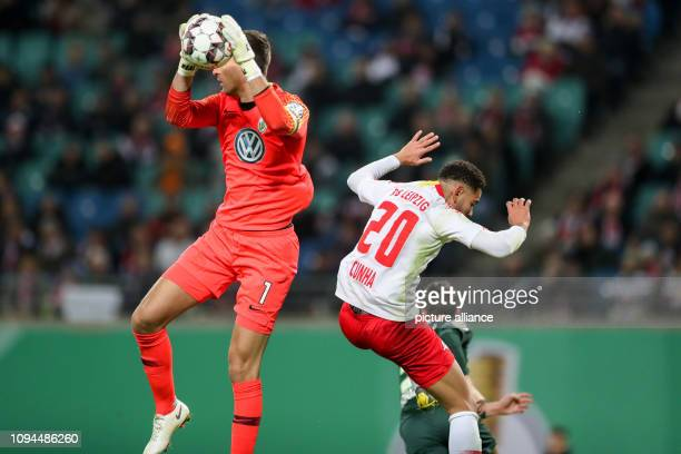 Soccer DFB Cup Round of 16 RB Leipzig VfL Wolfsburg in the Red Bull Arena Leipzig Wolfsburg goalkeeper Koen Casteels saves a ball from Leipzig's...
