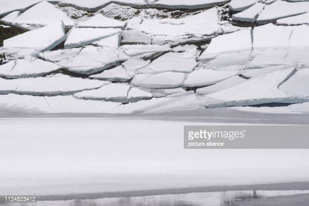 07 February 2019 SaxonyAnhalt Mandelholz Ice floes lie on the edge of the Mandelholz dam The artificial water body was frozen at a high level in...
