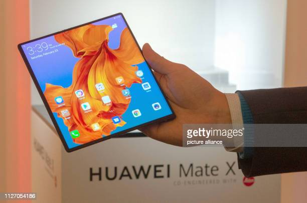 A man shows the Mate X smartphone from Huawei which has been opened into a tablet The Chinese electronics manufacturer presented the Mate X...
