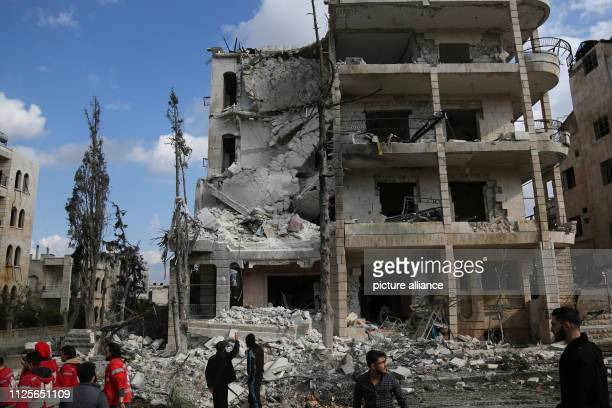 Syrians inspect the damage after two bomb explosions in the center of the city At first a car bomb exploded and as rescue forces wanted to help the...