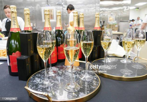 February 2019, US, Los Angeles: Bottles of Piper Heidsieck champagne stand with glasses in the kitchen of star chef Wolfgang Puck. 1500 bottles will...