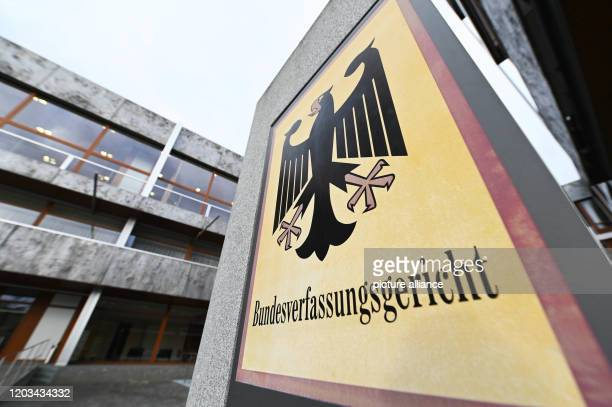 26 February 2020 BadenWuerttemberg Karlsruhe A sign with a federal eagle and the lettering Bundesverfassungsgericht stands before the court The...