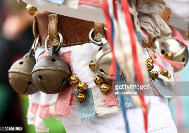 February 2020, Bavaria, Mittenwald: The Mittenwald bell stirrers move through the village during the traditional carnival. With the bells they ring...