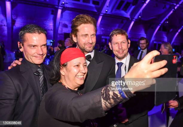 70th Berlinale Cinema for Peace Gala Lawyer Seyran Ates photographs actor Gerard Butler and her bodyguards Seyran Ates must be protected after death...