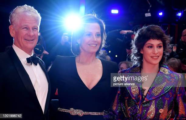 70th Berlinale Opening Gala Actress Sigourney Weaver stands beside her husband Jim Simpson and daughter Charlotte Simpson at the opening ceremony of...