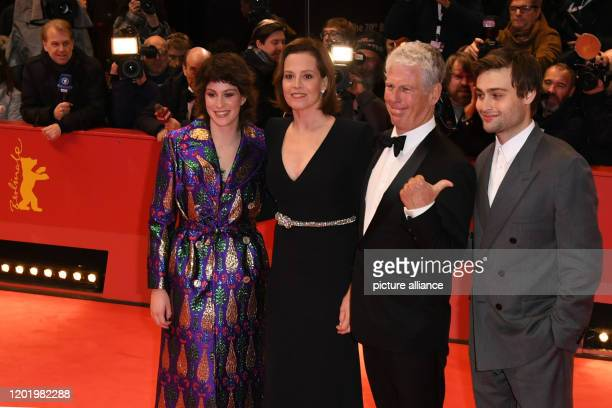 70th Berlinale Opening Gala Actress Sigourney Weave r stands next to her husband Jim Simpson and daughter Charlotte Simpson and actor Douglas Booth...