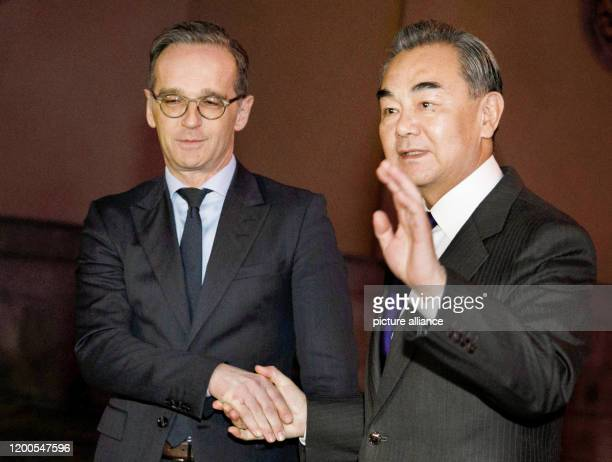 February 2020, Berlin: Heiko Maas , Foreign Minister, receives the State Councillor for Foreign Affairs and Foreign Minister of the People's Republic...