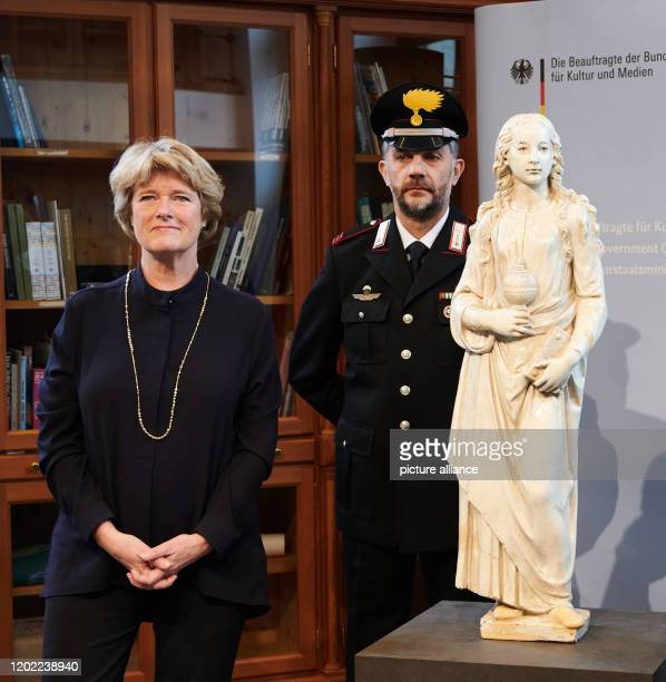 Monika Grütters Minister for Culture and Media stands next to a guarded statue The statue represents Mary Magdalene The Nazi art theft was in Italian...