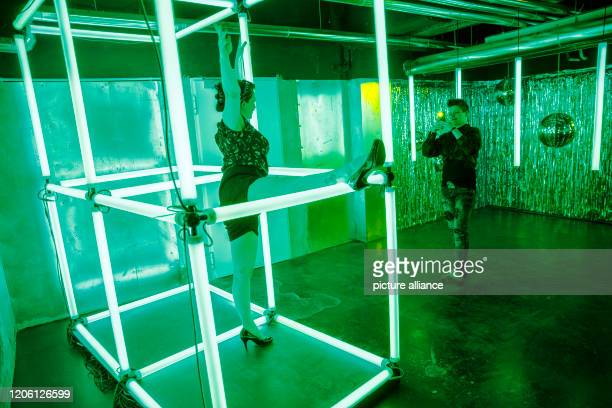 February 2020, Berlin: Visitors photograph each other in one of several different settings in the Selfie Museum The WOW! Gallery. 25 interchangeable...